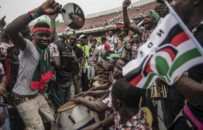 National Democratic Congress supporters had to swallow a bitter pill when the party conceded defeat to Nana Akufo-Addo's New Patriotic Party in December. Photo: Cristina Aldehuela/AFP