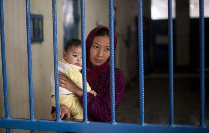 Prisoner Nuria with her infant boy at Badam Bagh