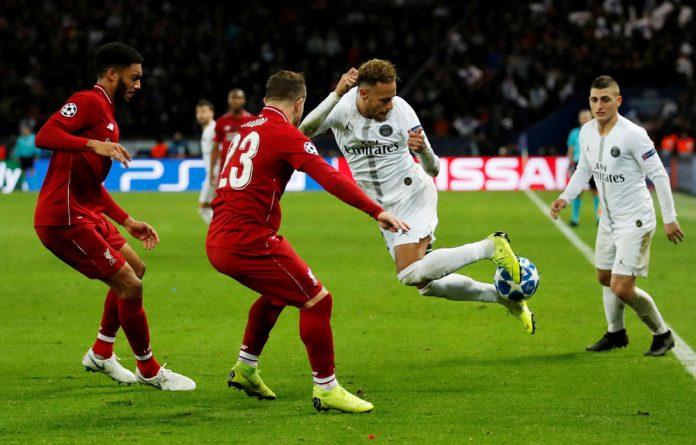 Paris St Germain's Neymar in action with Liverpool's Xherdan Shaqiri and Joe Gomez