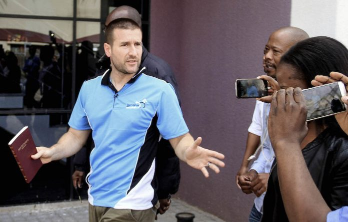 Controversial US Pastor Steven Anderson leaves the Botswana Department of immigration after being issued a deportation order by Botswana authorities