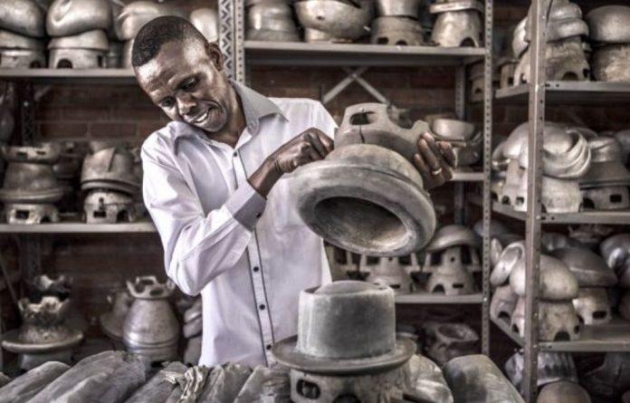 Pressing Matter: Mabro Hats milliner Jimmy Baloyi hard at work.