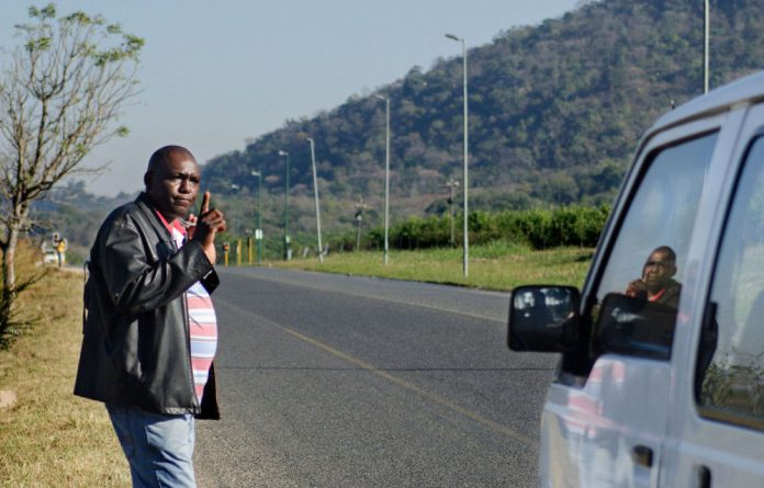Hezekiel Nyoni hails a taxi to make the 70km trek to Barberton to get treatment for multidrug-resistant tuberculosis.