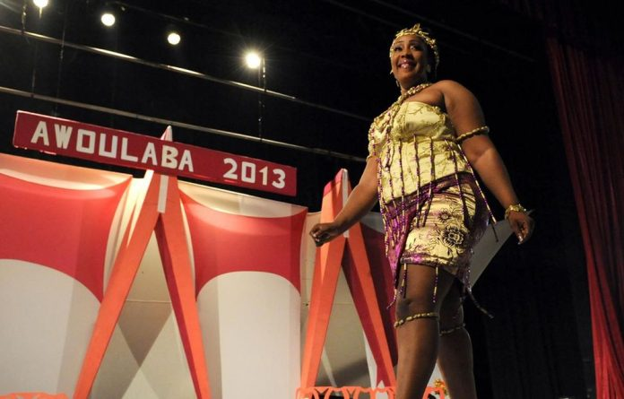 A contender takes part in the Awoulaba beauty pageant final in Abidjan.