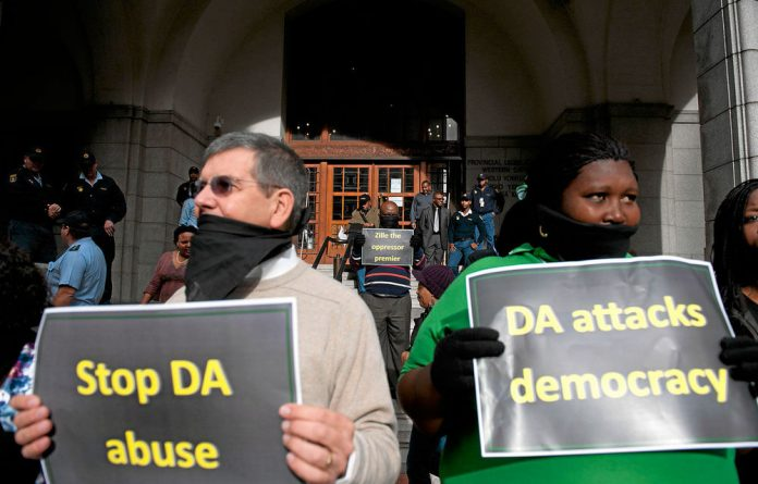 Battle lines: Protesters this week berate the DA for wanting to close 17 schools.