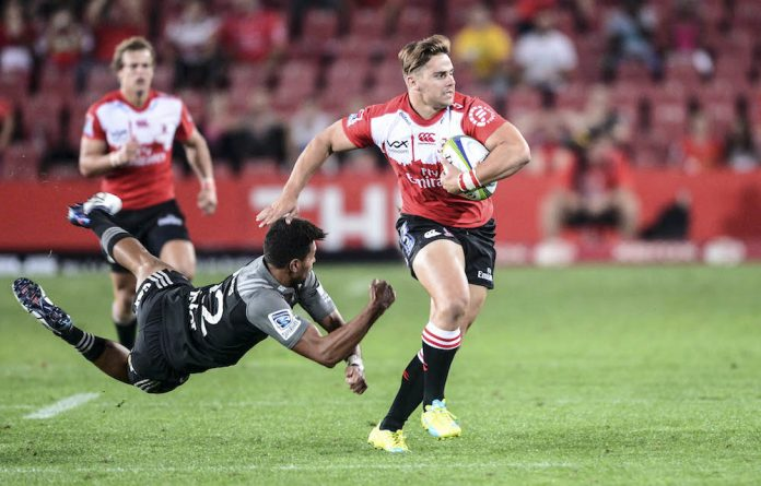 Now for the rematch: Rohan Janse van Rensburg of the Lions evades Ben Volavola of the Crusaders during the match in Johannesburg in April.