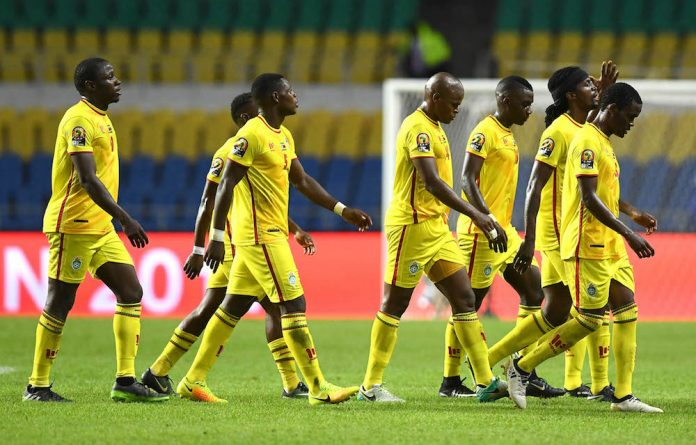 Zimbabwe's players walk off the pitch at half-time during the 2017 Africa Cup of Nations group A football match between Zimbabwe and Tunisia.