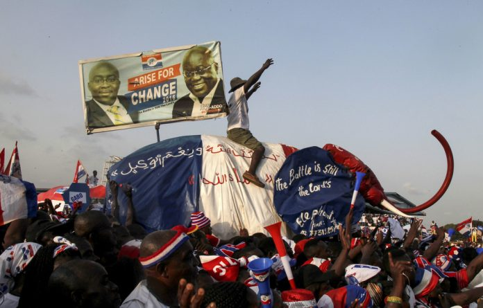 Supporters of Ghanaian presidential candidate Nana Akufo-Addo of the opposition New Patriotic Party
