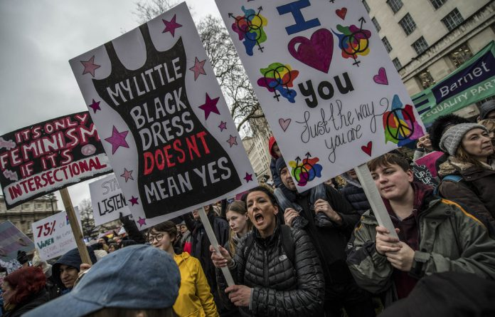 Demonstrators at a Time's Up rally in London. The initiative was launched in response to the #MeToo movement and the Harvey Weinstein scandal.