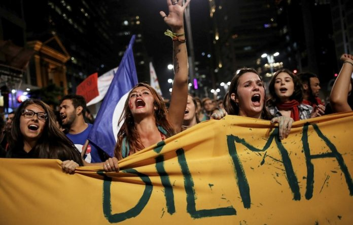 Crisis mode: Women shout slogans during a protest against Brazil's interim President Michel Temer