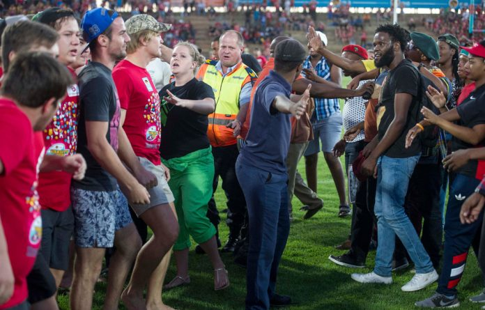 Protesting students at the University of Free State clash with supporters of the university's rugby team on the field on Monday night.