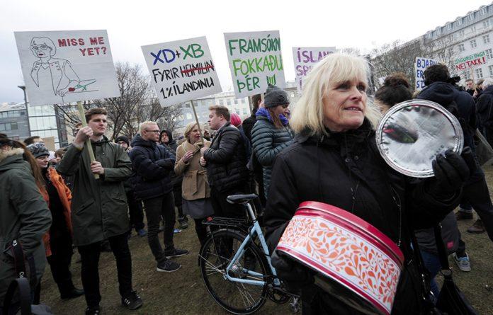 People demonstrate against Iceland's Prime Minister Sigmundur David Gunnlaugsson in Reykjavik