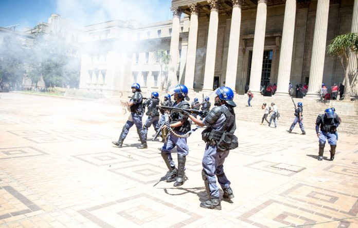 Police clash with protesters during #FeesMustFall protests at Wits.