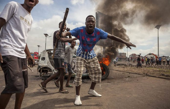 Power play: Violence erupted over President Joseph Kabila's refusal to hold elections and step down. Photo: Eduardo Soteras/AFP