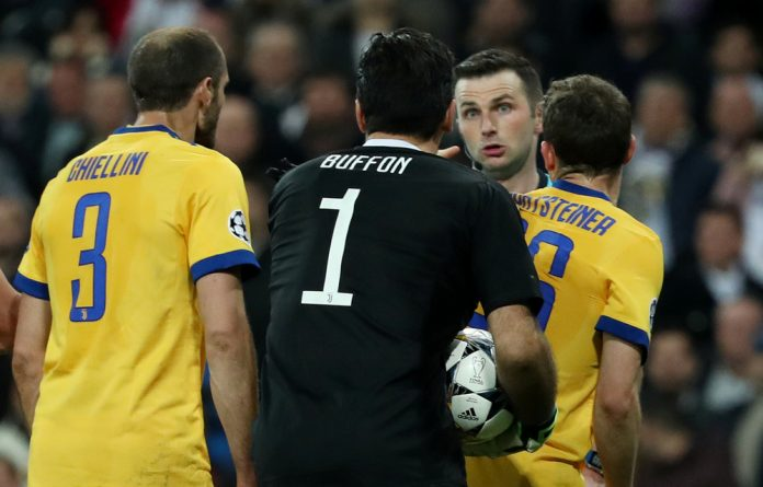 Juventus' Gianluigi Buffon remonstrates with referee Michael Oliver after being sent off