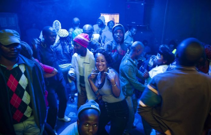 Slaves to the rhythm: Inanda clubbers enjoy the music specially tailored to the drug of choice for some of them; others will perhaps 'top up' so they can party the entire weekend away.