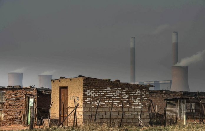 A house in front of the coal-fired Duvha Power Station on the outskirts of Witbank.