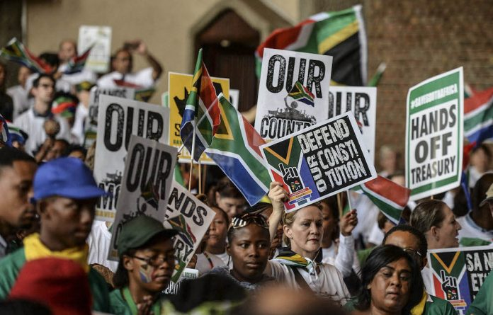 ​Backlash: Save South Africa supporters protest in Pretoria on November 2. Zuma and former finance minister Des van Rooyen