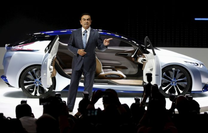 Carlos Ghosn in front of the Nissan IDS Concept car during a presentation at the 44th Tokyo Motor Show.