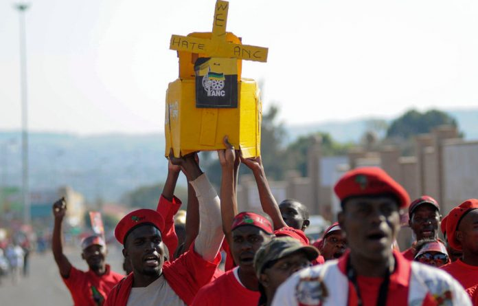 Supporters of Julius Malema's Economic Freedom Party hold up a mock coffin of the governing ANC during in Pretoria in 2014. The EFF's entry into parliament is the most dramatic example of political realignment in South Africa. Skyler Reid/Reuters