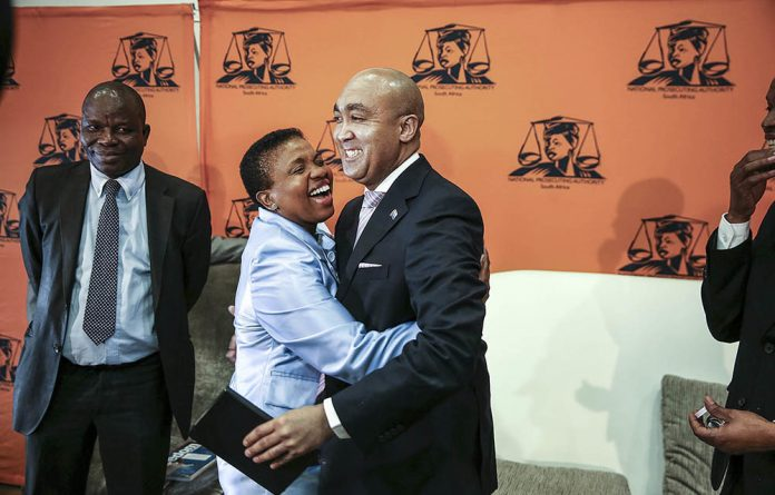 Nomgcobo Jiba hugs Shaun Abrahams after his announcement in May that the high court had dismissed a DA application for an inquiry into her fitness to hold office.