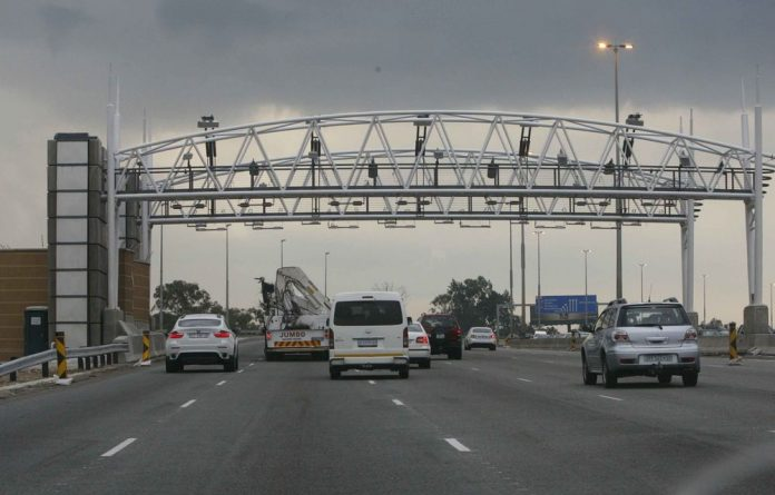 Tuesday marked the start of the e-toll system and motorists trickled in to get tagged. Some are still against it and are willing to be arrested.