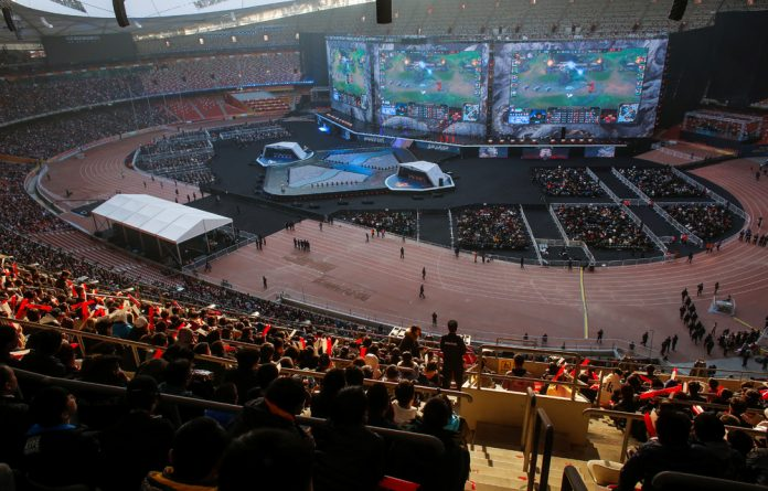People watch the League of Legends 2017 World Championships Grand Final esports match between Samsung Galaxy and SK Telecom T1 at the Beijing National Stadium