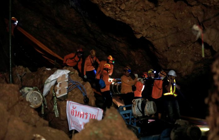 Rescue workers take out equipment after 12 soccer players and their coach were rescued in Tham Luang cave complex in the northern province of Chiang Rai