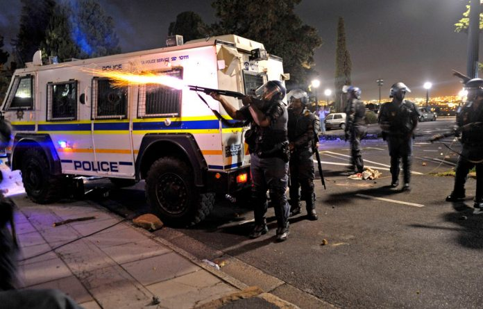 Police clash with students during a protest at UCT on Tuesday night.