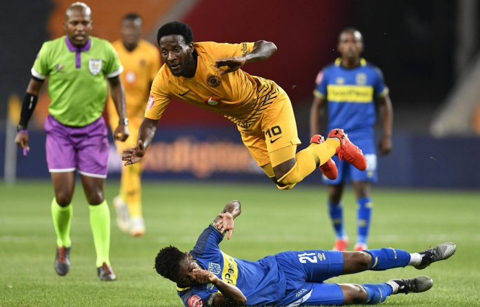 Airborne: Siphelele Ntshangase of Kaizer Chiefs flies over Cape Town City's Thato Mokeke on Wednesday.