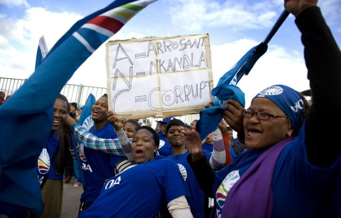 DA supporters danced and sang while waiting for party leader Helen Zille to arrive back in the Western Cape on Saturday.