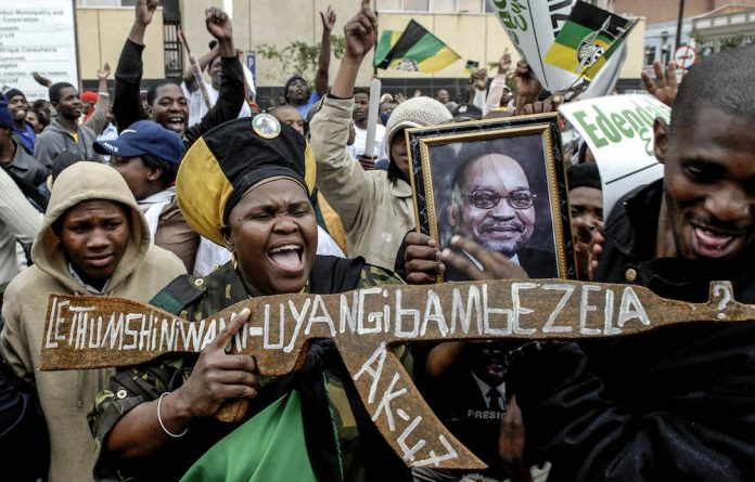 Supporters of ANC leader Jacob Zuma celebrate outside the Pietermaritzburg High Court in September 2008 after a South African judge threw out corruption charges
