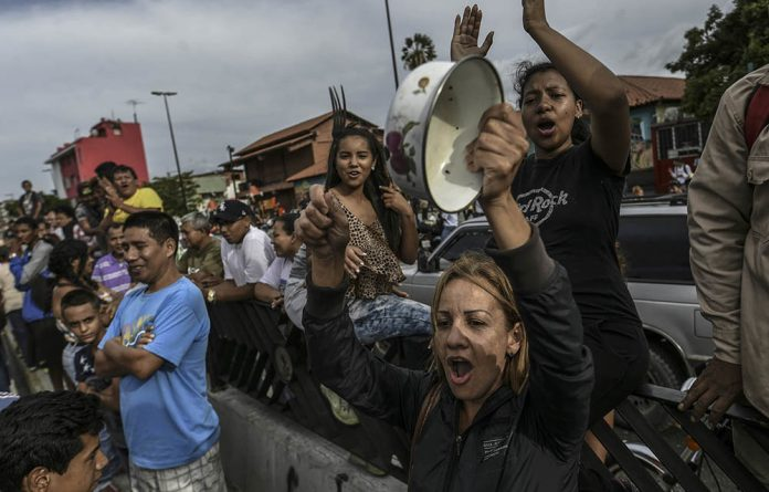 Residents of a low-income neighbourhood in Caracas rally in protest at the lack of food on June 14.