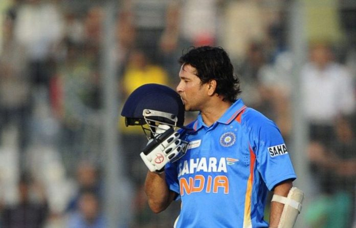 Tendulkar walked off with his bat raised to acknowledge the rousing ovation.