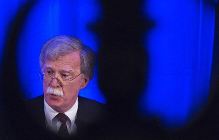 Immune: National security adviser John Bolton said the United States will arrest International Criminal Court judges and officials if the court charges Americans with war crimes.