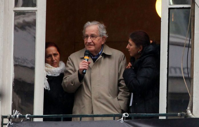 Noam Chomsky speaks on the balcony of the offices of Armenian newspaper Agos during a commemoration ceremony for slain journalist Hrant Dink in Istanbul.