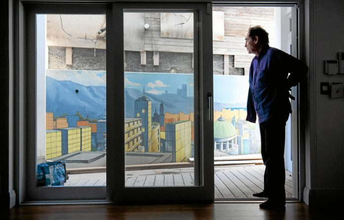 Judge for yourself: Albie Sachs in his home at Clifton beach  in Cape Town with a mural painted by his son Alan.