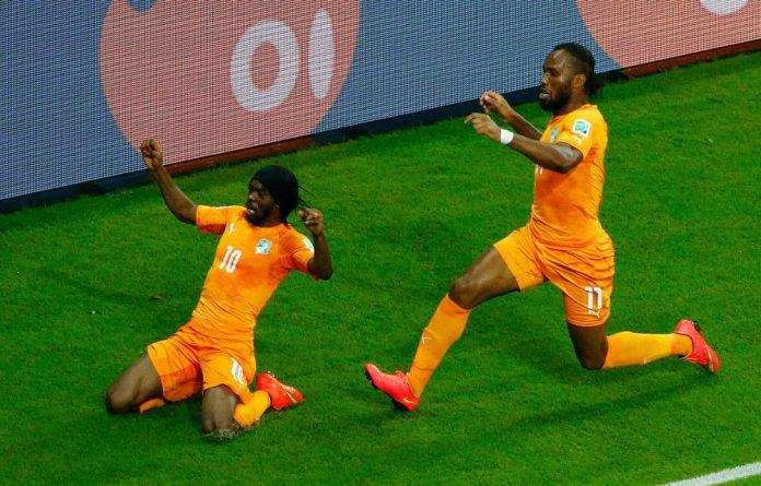 Gervinho left and Didier Drogba celebrate their goal against Japan.