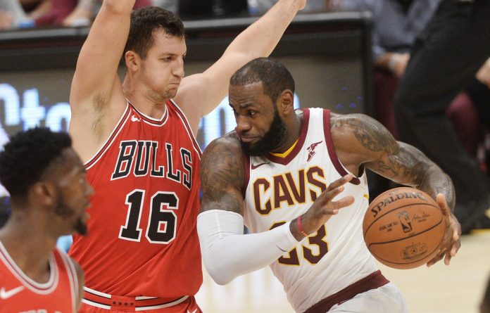 Cleveland Cavaliers forward LeBron James drives to the basket against Chicago Bulls guard Paul Zipser during their preseason encounter.