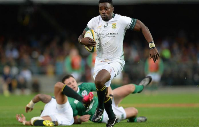 Lwazi Mvovo of the Springboks on his way to score a try during the 1st Castle Lager Incoming Series Test match between South Africa and Ireland.