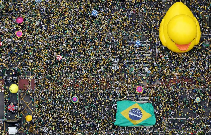 Demonstrators attend a protest against Brazil's then president Dilma Rousseff in Sao Paulo on March 13 2016.