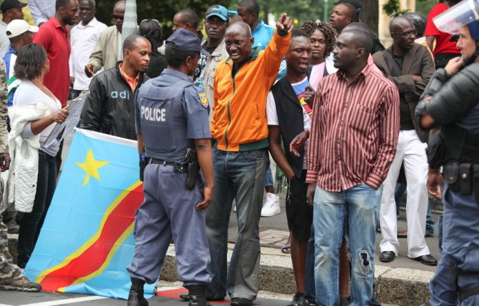 Scores of Congolese nationals protested outside the DRC embassy in Pretoria