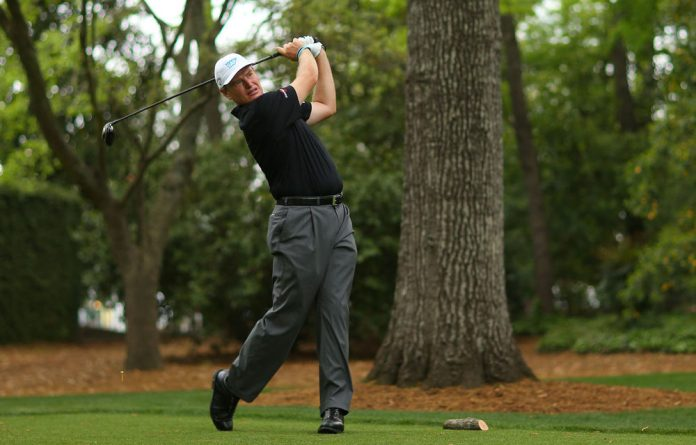 Ernie Els hits a tee shot on the second hole during the second round of the 2013 Masters Tournament at Augusta National Golf Club.