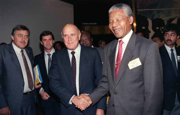 Reconciliation: Nelson Mandela shakes hands with FW de Klerk after the first day of the Convention for a Democratic South Africa in 1992.