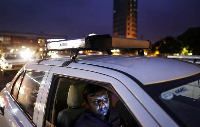 Uber taxi driver in New Delhi