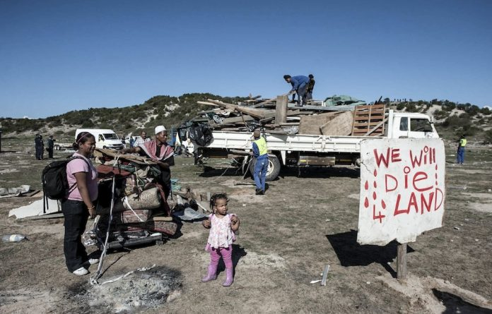 SAPS and Metro Police moved in and forcibly removed hundreds of people who had built shacks on an open field in Tafelsig
