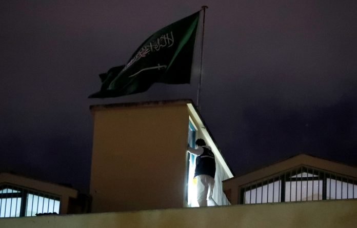 A Turkish forensic expert is seen as he works inside Saudi Arabia's consulate in Istanbul.