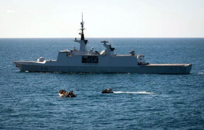 EU Naval Force French frigate FS Surcouf apprehends suspected pirates on January 6 2013 off the Somali coast.