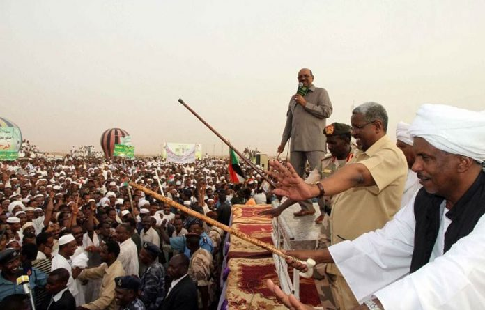 Sudan's President Omar al-Bashir speaks to a crowd of people in north Khartoum on June 8 2013.