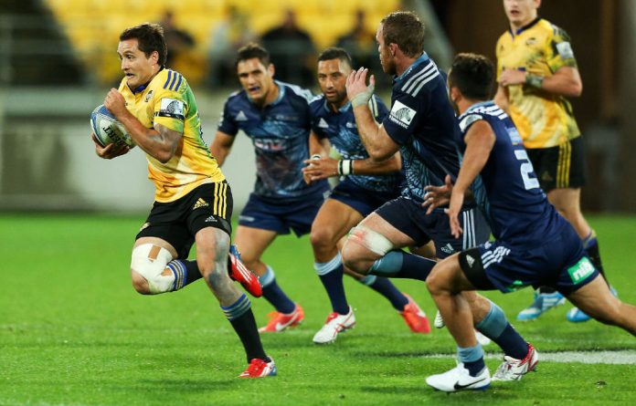 Tim Bateman of the Hurricanes makes a break during the round ten Super Rugby match between the Hurricanes and the Blues at Westpac Stadium.