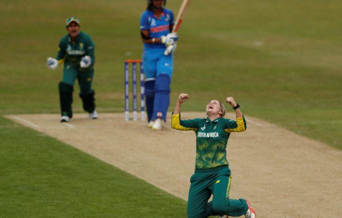 South Africa's Dane van Niekerk celebrates taking the wicket of India's Harmanpreet Kaur.